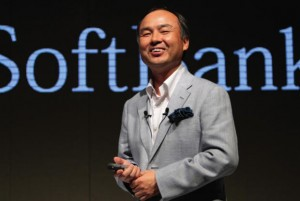 Photo of Masayoshi Son standing in front of the word 'SoftBank'.